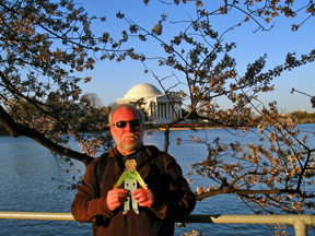 Uncle Tommy and Flat Nicholas pose before the cherry trees on the Tidal Basin, with the Jefferson Memorial in the background.
