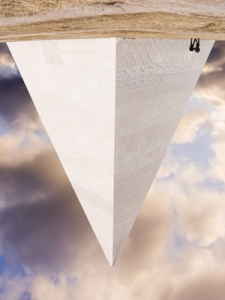 Photo of a pyramid that has been flipped to be inverted.