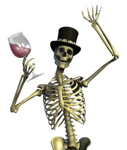 Smiling skeleton in tophat raising a glass of red wine.