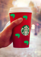 Green commas drawn on a Starbucks cup