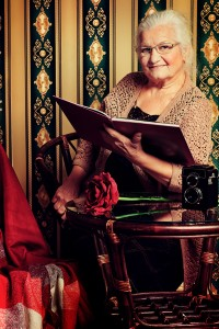 Portrait of a smiling senior woman reading a book at home Old-fashioned style Can Stock Photo Inc. prometeus