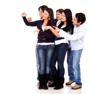 Group of people pointing at an imaginary object - isolated over a white background Can Stock Photo Inc. Andres